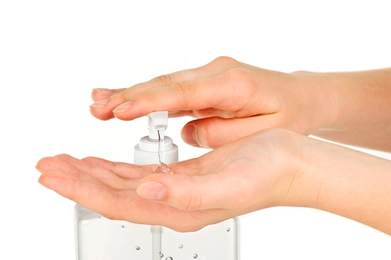 Hands with sanitizer gel